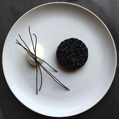 """Minimalist Art Plating"" Black ink risotto with mozzarella and fried black spaghetti by @royalebrat #GourmetArtistry"