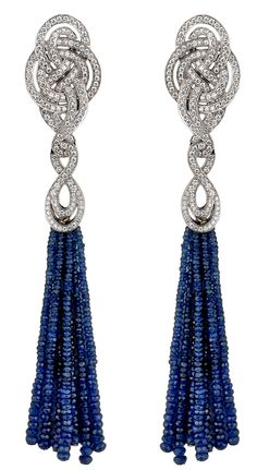 Earrings from Garrard's Entanglement collection with a delicate bead tassel of sapphires below a gold and diamond knot.