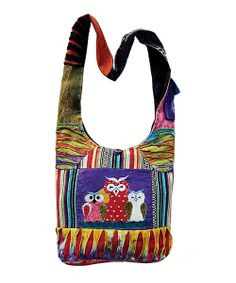 Tote the essentials in standout style with this one-of-a-kind handcrafted hobo. Boasting bright bursts of color, pretty patchwork and an adorable owl design, this bag brings breezy boho flair to any ensemble.Note: Because this piece is completely handmade, colors may differ dramatically from what is pictured.