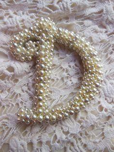 Super cute pearl Initials on my friend Amanda's Etsy shop, The Snuggled Stitch