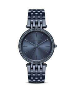 This monochrome Michael Kors timepiece, in a bold blue hue, is an accessory staple you'll turn to time after time.   Imported   Case size: 39mm   Deployant buckle closure   Water resistant to 5 ATM  