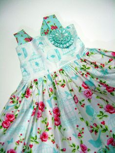 Little girls dress with birdcages and roses