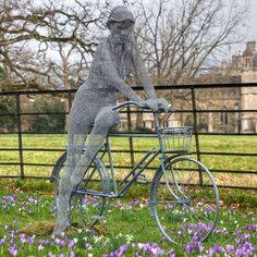 The Lady and the Bicycle, photographed by Steve Watson    The Wood Cutters Sprite by the UK artist Derek Kinzett crafts these amazing figurative sculptures by cutting and forming different kinds of wire. Kinzett closed a solo exhibition yesterday for The National Trust, Lacock Abbey, Wiltshire, England