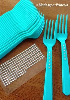 Super Quick Party Tip Bling Your Plasticware with just some inexpensive crystals and forks from the dollar store.