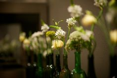 wine bottle flower vases. SO easy to do DIY!