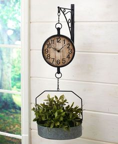 The Wall-Mounted Farmhouse Clock is the perfect finishing touch for your country home. Inspired by a vintage farmhouse scale, this clock hangs from a scrollwork bracket and has a galvanized bucket suspended - Wall-Mounted Farmhouse Clock Farmhouse Clocks, Farmhouse Bedroom Decor, Antique Farmhouse, Country Farmhouse Decor, Farmhouse Style Kitchen, Modern Farmhouse Kitchens, Farmhouse Ideas, Farmhouse Design, Primitive Country