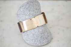 """Skate Mini Cuff $165.00 Mini leather cuff. Made in Los Angeles.  Details: Designer - Samantha Grisdale Material - Leather, Bronze Band width - 1"""""""