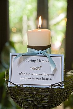 In memory, very sentimental! Use the bridesmaids colors for the larger ribbon and the grooms color for the smaller ribbon. Tie a cross or angel charm to dangle from the smaller ribbon. Very touching!