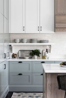 Soft blue gray kitchen cabinets are so stunning and love the mix of painted cabi. Soft blue gray kitchen cabinets are so stunning and love the mix of painted cabinets with wood cabinets as well Blue Gray Kitchen Cabinets, Kitchen Cabinet Colors, Painting Kitchen Cabinets, Kitchen Redo, Home Decor Kitchen, Kitchen Interior, New Kitchen, Home Kitchens, Kitchen Remodel