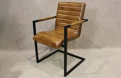 Tan leather armchair with steel frame, this chair has an extremely comfortable seat with stitched detail. The black steel frame complements the leather. Industrial Chair, Industrial Style, Outdoor Chairs, Outdoor Furniture, Outdoor Decor, Tan Leather Armchair, Asian Furniture, Counter Height Stools, Steel Frame