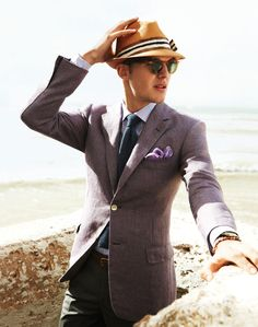 Jacket, madras shirt, navy knit tie, lilac pocket square, tortoise sunglasses with green lenses