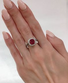 handmade ring with a fancy bezel and twisted domed band Genuine  emerald cut ruby set in solid silver Ruby is Julys birthstone.