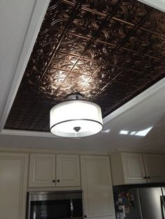 Tin ceiling accent. a way to cover up an old ugly kitchen dome light fixture & remodel flourescent light box in kitchen | We also replaced the ...