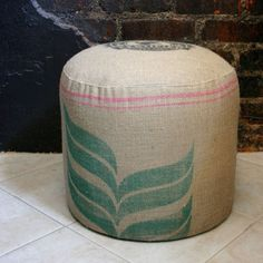 ottomans made out of coffee bags... for casual seating low enough to tuck under the work stations (i.e. your apple store inspiration)