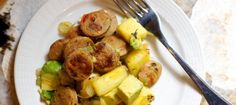 Chicken Sausage with Pineapple and Avocado.  I might side it w/ brussel sprouts?