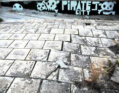 """Pirates City"" plastic color and spray on wall."