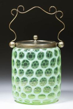 "HONEYCOMB / BIG WINDOWS CRACKER / BISCUIT JAR, green (black lighted) opalescent, cylinder form with nickel-silver plated rim and cover. Late 19th/early 20th century. 9.5""H (jar 5.75""H) x 4.75""D"