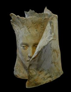 Terracotta Emerging Form or Face sculpture for sale by artist Paola Grizi titled: Inside Faces
