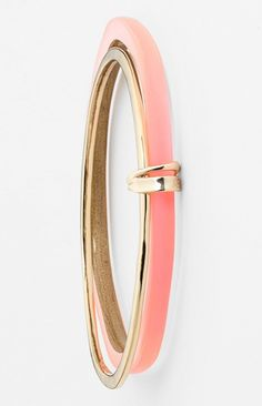 Pretty pink and gold stacked Alexis Bittar bangle.