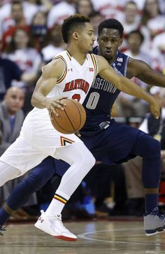 Maryland guard Melo Trimble, left, drives against Georgetown guard L.J. Peak