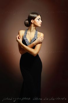 beautiful woman in sexy evening dress against dark background