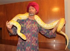 Arabian themed Snake Walkabout Act to hire - fully insured and licensed to perform at live events. Corporate Entertainment, Party Entertainment, Uk Parties, Yellow Snake, Walkabout, The A Team, Arabian Nights, Belly Dancers, Live Events