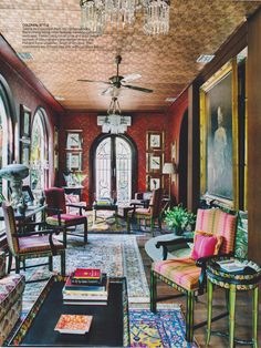 COLONIAL STYLE Taking inspiration from old conservatories the morning living room features bamboo patterned wallpaper, framed pictures of birds and a full length portrait of Vasundhara's grandfather-in-law. The chandeliers are vintage cast iron with cut-glass lusters. Designed by Delhi based Adil Ahmad, the home is a confluence of partnering beautiful things that have a personal legacy with complementary contemporary objects. #GoodEarthBespoke #GEbespoke #ArchitecturalDigest