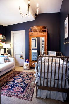 Dark walls and seer sucker crib bedding in this gender neutral nursery Dark Gray Nursery, Nursery Neutral, Neutral Nurseries, Navy Blue Nursery, Gray Crib, Jenny Lind Crib, Home Interior, Interior Design, Dark Walls