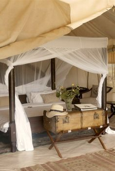 Love this canopy bed with the trunk, exactly what I have in mind when I think of safari style interior. Cottar's Safari Camp - Maasai Mara, Kenya Glamping, Safari Bedroom, Estilo Colonial, British Colonial Decor, Safari Decorations, Campaign Furniture, Decoration Inspiration, Safari Chic, Luxurious Bedrooms