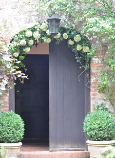 Ramster Hall, entrance decorated by Spriggs Florist with hydrangeas and garden foliages.