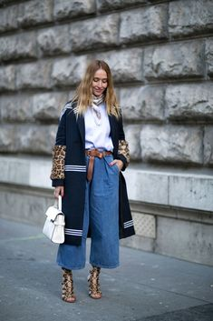 Wide-leg jeans, a striped coat, and knotted belt.