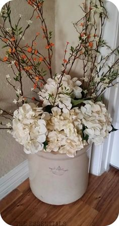 Spring has finally arrived! For months now I have been wanting to dress up my grandparents antique crock that sits in our entryway, but stil...