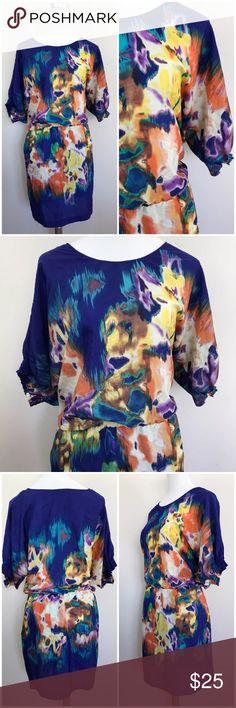 """ECI New York Colorful Dress Printed Dolman Batwing Blousey colorful dress with dolman-style sleeves, pockets, and drop elastic waist. Sleeve cuffs are elastic. The top of the dress is unlined, but the skirt is lined. Material is semi-sheer.  M E A S U R E M E N T S Armpit to armpit about 21"""" Waist 15.5"""" flat Hips 22"""" flat Length 40"""" ECI Dresses"""