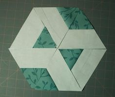 Interesting use of pieced triangles (or equilateral triangles and half-hexagons)