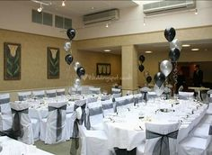 "Black and White Ballons at extremities of room.  Love the ""spiral"" effect they create with the balloons."