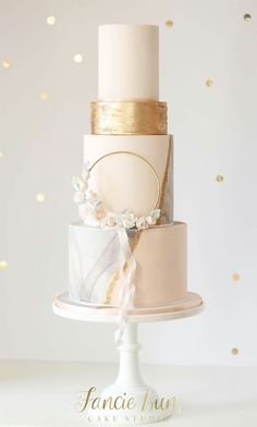 Gold hoop dressed with blossoms & flowing silk ribbon.Fancie Buns Cake Studio specialise in designing and creating style focused, contemporary chic wedding cakes and dessert tables. Blush Wedding Cakes, Wedding Cake Fresh Flowers, Luxury Wedding Cake, Elegant Wedding Cakes, Wedding Cake Designs, Wedding Gowns, Pretty Cakes, Beautiful Cakes, Première Communion