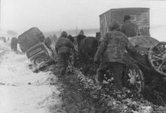 And the retreat came. German troops trudge across the snowy landscape on their way west and out of the Ukraine in Jan 1944.Horse-drawn carriages doing better than motor vehicles, which break down are are abandoned on the side of the muddy path. During such retreats casualties from the weather, disease, and starvation are usually higher than those due to battle.