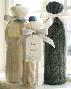 Use the sleeve from an old sweater to cover a bottle. Cute winter idea…