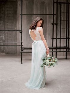 Color wedding dresses are trending, and this mint wedding dress from Milamirabridal features a sweetheart neckline, lacey key hole back and a flowing pastel mint chiffon skirt.