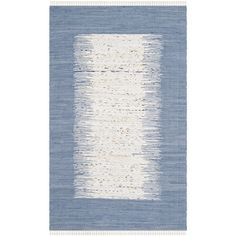 Anchor your dining set or living room seating group in style with this hand-woven cotton rug, showcasing an ikat-inspired color-block motif in dark blue.