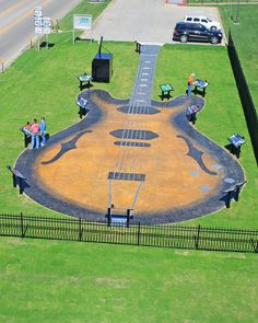 Guitar Walk in Walnut Ridge Arkansas was built as a tribute to the rockabilly legends who played along Rock n' Roll Hwy 67 in NE Ark during the 50's, birthing rock n roll. the walk has an 11 station tour  positioned around the edge, complete with photos and personal audio stories about the artists, told as only Sonny Burgess could tell them.