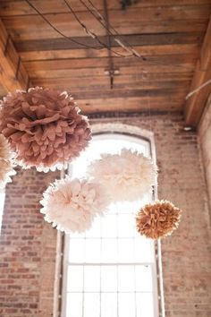 Gonna try this ;) Tissue paper poms - cheap and charming decor for loft-style wedding