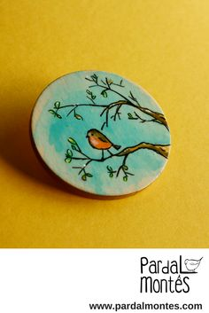 Hi! Welcome! :) You've just found one of handpainted wood brooches or pins. It is part of a series of medallions inspired by nature and forest scenes. This one features a robin on a tree branch with a blue sky background. It is a great gift for (but not only) bird lovers.