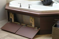 Bath tub skirt that opens up for plumbing access or hidden storage.