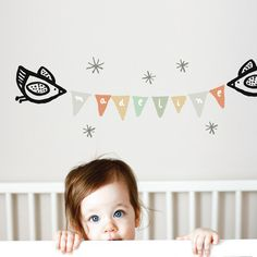 I don't really like wall decals but if I were to do one, this Wee Gallery banner is really cute.