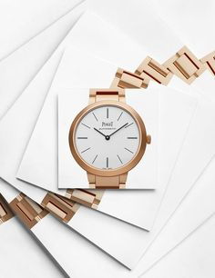 Piaget watch creative still life photography. Clean, white, paper, stepped squares. Watches, timepiece, expensive watch fashion. Luxury goods still life photographer, Josh Caudwell. For commercial, advertising, product and editorial. London, New York, Paris, Milan.