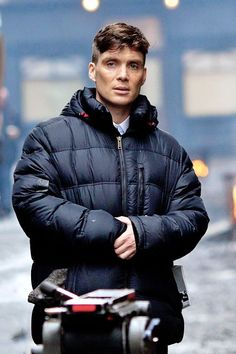 Cillian Murphy on the set of Peaky Blinders in with Tommy Shelby's flat cap peeking out of his parka pocket. Peaky Blinders Thomas, Cillian Murphy Peaky Blinders, Pretty Men, Gorgeous Men, Beautiful People, Cillian Murphy Tommy Shelby, Look At My, Raining Men, Portraits