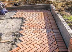 Orange brick paving stones pattern in the construction process of a courtyard Backyard Fences, Fenced In Yard, Backyard Landscaping, Red Brick Paving, Path Ideas, Fence Ideas, Diy Fence, Paving Contractors, Orange Brick
