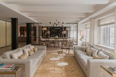"""""""It's like an old fashioned loft, but modernized,""""Nancy Ruddy of CetraRuddy says of the 4,800-square-footfull-floor model residence, which will be listed for $12.25 million. (All artwork featured in the residence is by Rick Klauber.)   - ELLEDecor.com"""
