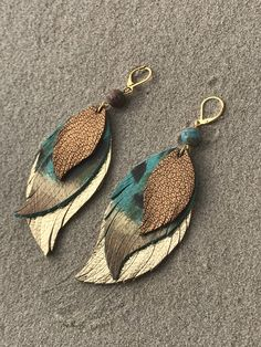 These are fun! I wore a pair already and got a ton of compliments. These are in layered in pheasant pattern teal leather with gold/copper painted tips and gold feather. Pretty gemstone bead on top. Leather Jewelry Making, Diy Leather Earrings, Beaded Earrings, Earrings Handmade, Handmade Jewelry, Handmade Bracelets, How To Make Leather, Real Leather, Painting Leather